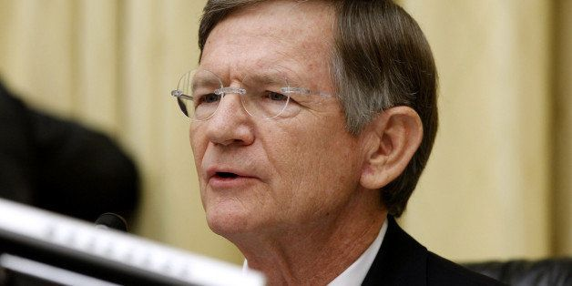 House Judiciary Committee Chairman Rep. Lamar Smith, R-Texas, questions Attorney General Eric Holder on Capitol Hill in Washington, Thursday, June 7, 2012, during the committee's oversight hearing on the Justice Department. (AP Photo/Charles Dharapak)