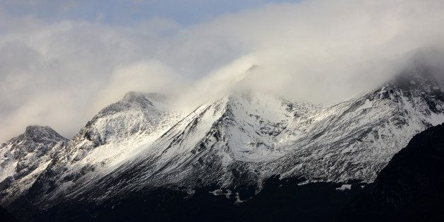 mist and clouds rolling over snow covered mountain tops outside ushuaia patagonia tierra del fuego argentina