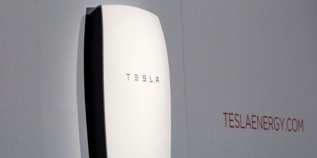 "Tesla's newest product ""Powerwall"" is unveiled on stage in Hawthorne, Calif., Thursday, April 30, 2015.  Tesla CEO Elon Musk"