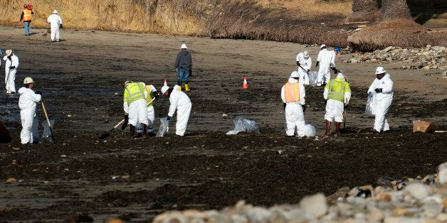 Clean up crews remove oil-laden sand on the beach at Refugio State Beach, site of an oil spill, north of Goleta, Calif., Wedn