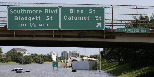 Vehicles are left stranded on Texas State Highway 288 in Houston, Texas on May 26, 2015. Heavy rains throught Texas put the c