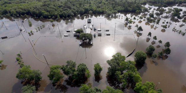 Baseball fields Bear Creek Park are covered by floodwaters  Saturday, May 30, 2015, in Houston. The Colorado River in Wharton