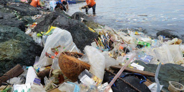 Plastic bags and other rubbish are collected from the waters and shoreline of Manila Bay on July 3, 2014 during a campaign by