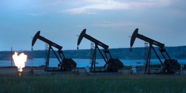 NEW TOWN, ND - AUGUST 13:   View of three oil wells and flaring of natural gas on The Fort Berthold Indian Reservation near N