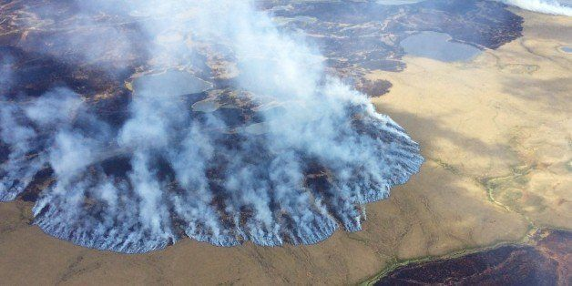 In this Sunday, June 7, 2015 photo, smoke rises from the Bogus Creek Fire, one of two fires burning in the Yukon Delta Nation