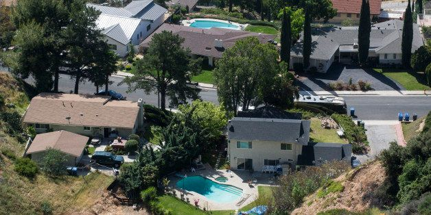 Homes with swimming pool are seen, Thursday April 2, 2015 in Altadena, Calif. California Gov Jerry Brown on Wednesday, April
