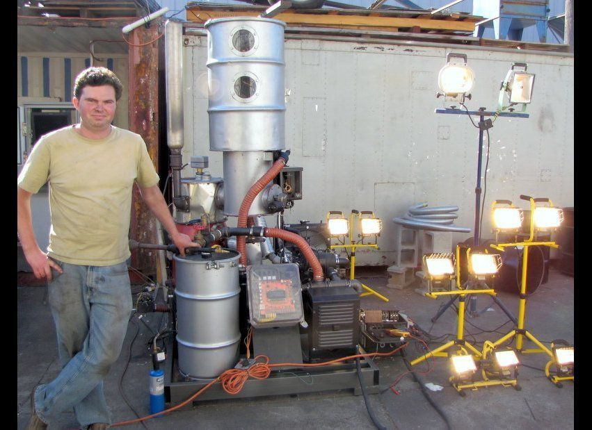 Chief Scientist Bear Kaufman with the GEK Power Pallet -- a 10kw generator powered by wood chips. The only emissions are the