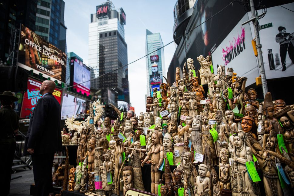 Over one ton of ivory, confiscated by law enforcement, sits on display before being destroyed in Times Square.