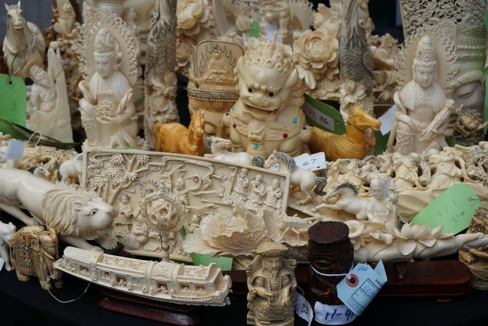 Confiscated ivory carved into animal figurines and other characters sits in Times Square before being crushed into dust.