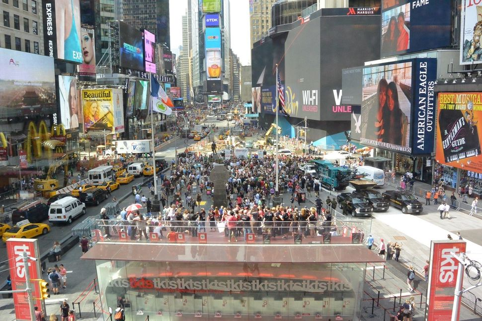 A crowd gathers in Times Square to watch the ivory crush.