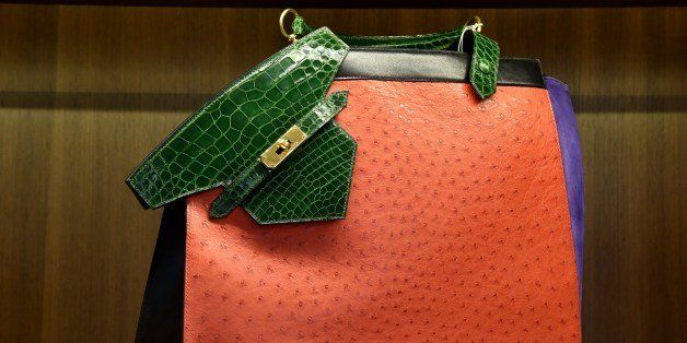 An Hermes extremely rare shiny Vert emerald alligator, rouge Vif ostrich, violet Veau doblis suede and black calf box leather