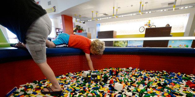 CARLSBAD, CA - SEPTEMBER 17: Children play with Lego blocks in the lobby of North America's first ever Legoland Hotel at Lego