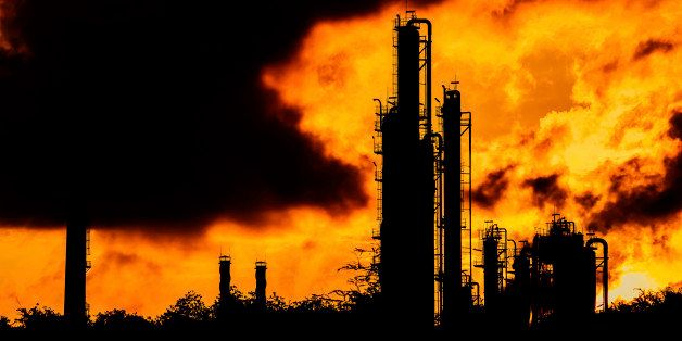 silhouette of refinery plant on evening background