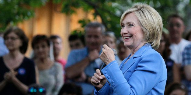 Democratic presidential candidate Hillary Rodham Clinton smiles as she listens to a question during a house party in Windham,