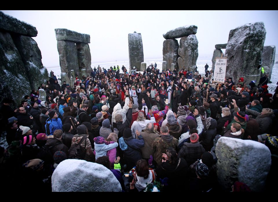 STONEHENGE, ENGLAND - DECEMBER 22: Hundreds of druids and pagans celebrate the winter solstice at Stonehenge on December 22,