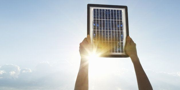 Woman hands with solar panel