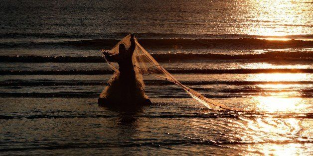 An Albanian fisherman throws his net at the shore in Vlora, 140 kilometers (85 miles) southwest of capital Tirana, Tuesday, D