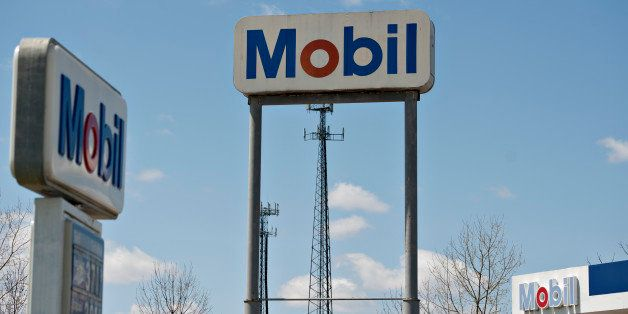 Mobil signage stands at the Kickapoo Service Center in Edwards, Illinois, U.S., on Thursday, April 25, 2013. Exxon Mobil Corp