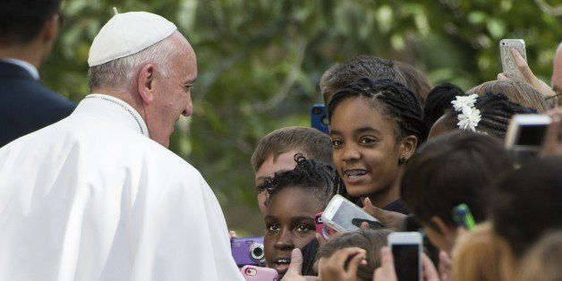 Pope Francis greets well-wishers as he leaves the Apostolic Nunciature to the United States  on September 24, 2015 in Washing