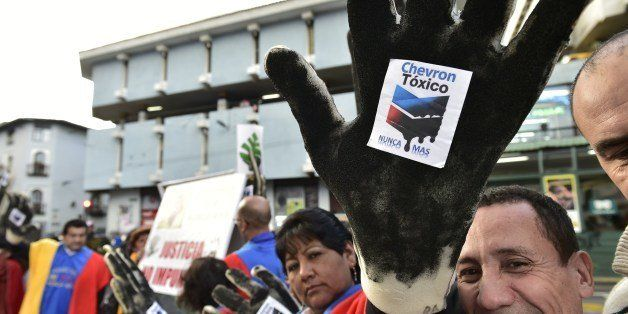 Activists protest against US multinational energy corporation Chevron at a square in Quito on May 21, 2014. Ecuadorean ecolog