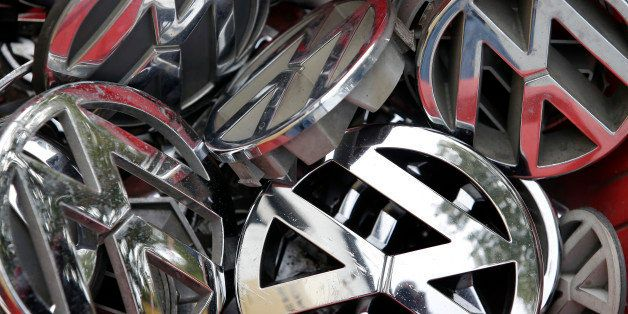 Volkswagen ornaments sit in a box in a scrap yard in Berlin, Germany, Wednesday, Sept. 23, 2015. The revelation that Volkswag