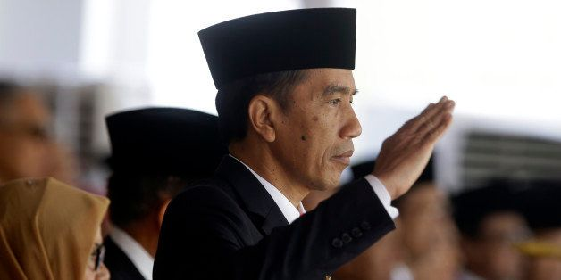 Indonesia's President Joko Widodo salutes during a flag raising ceremony for Independence Day at Merdeka Palace in Jakarta, I