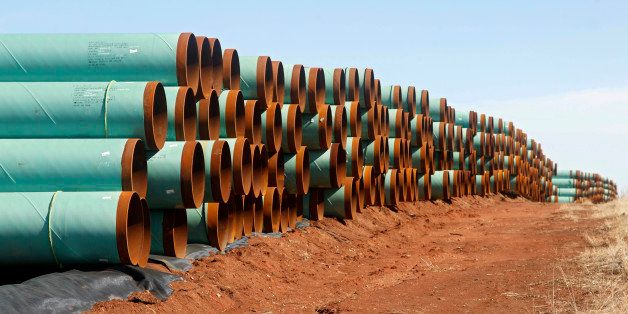 FILE - In this Feb. 1, 2012 file photo, rows of pipe ready to become part of the Keystone Pipeline are stacked in a field nea