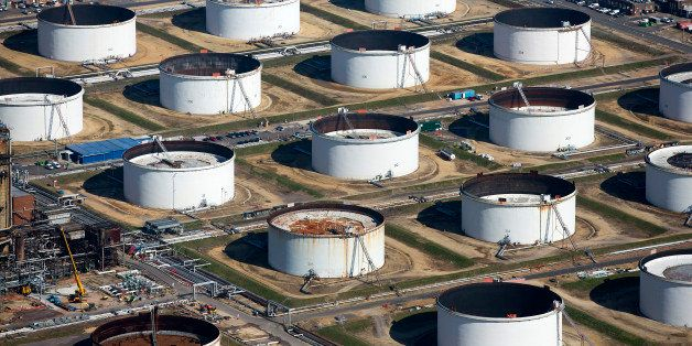 Oil storage tanks sit at the Esso oil refinery, operated by Exxon Mobil Corp. in Fawley, U.K., on Friday, Oct. 2, 2015. A 50