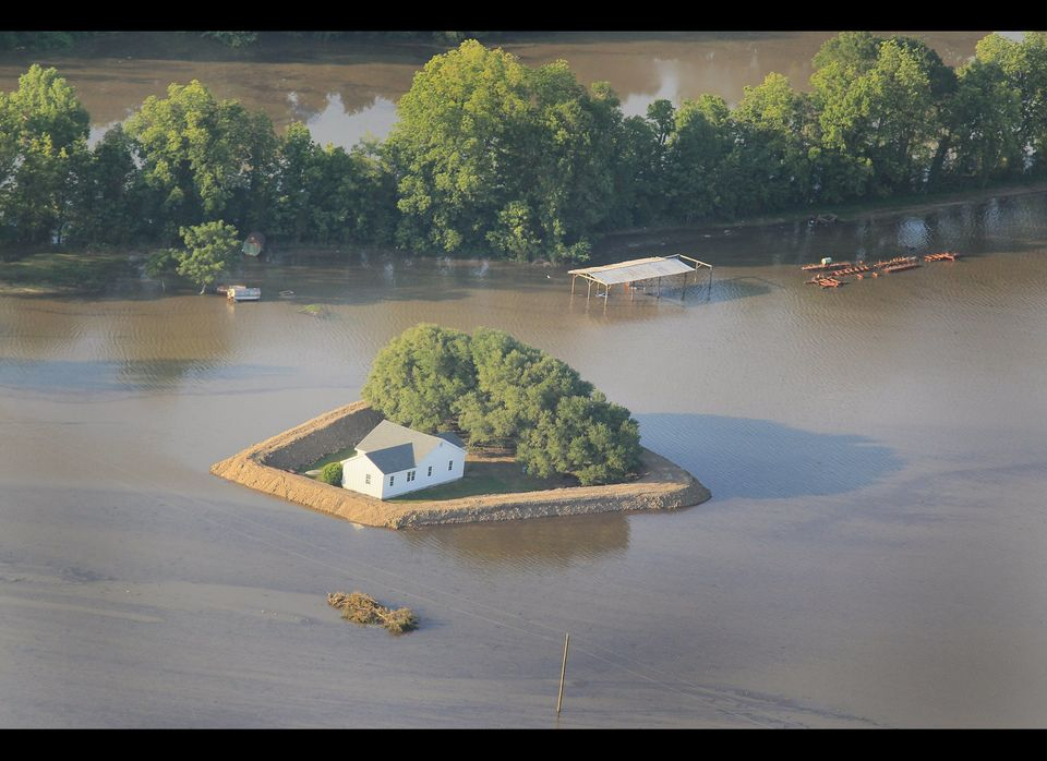 VICKSBURG, MS - MAY 18: A levee protects a home surrounded by floodwater from the Yazoo River May 18, 2011 near Vicksburg, Mi