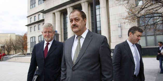 Donald 'Don' Blankenship, former chief executive officer of Massey Energy Co., center, and his attorney Bill Taylor, left, ex