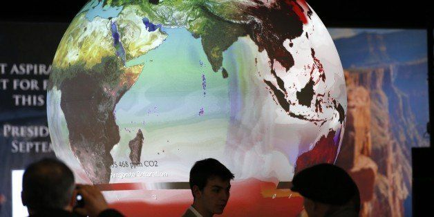 Visitors look at exhibits at the US stand at the COP 21, the United Nations conference on climate change, at Le Bourget, on t