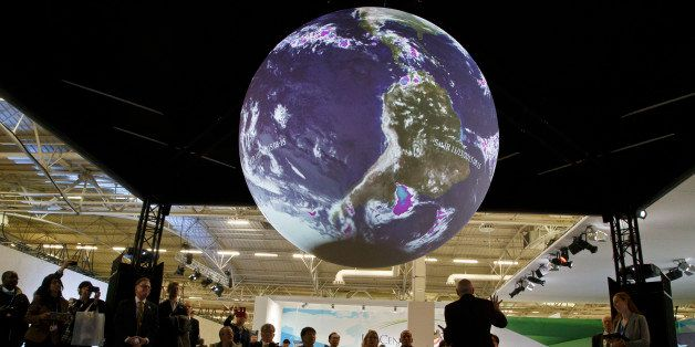 """Participants attend a panel entitle""""Science on a Sphere Presentation""""at the COP21, United Nations Climate Change Conference,"""