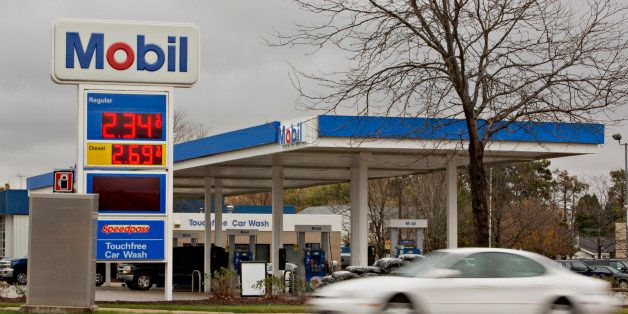 A vehicle drives past an Exxon Mobil Corp. gas station in Rockford, Illinois, U.S., on Wednesday, Oct. 28, 2015. Exxon Mobil