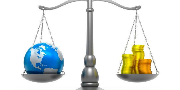 Scales with earth and money - isolated / clipping path________INSPECTOR__________Map file from here: http://visibleearth.nasa