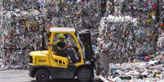 ELKRIDGE, MD - JUNE 18: A forklift operator is seen stacking bales of recyclables at the Waste Management Elkridge Material R