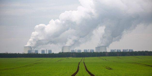 Chimneys emit vapor beyond agricultural land at Jaenschwalde lignite power plant, operated Vattenfall AB, in Peitz, Germany,