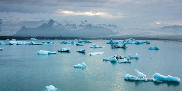 luminous blue icebergs floating ...