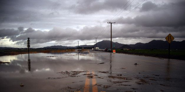 Water covers a closed Las Posas Road near Camarillo, Calif., after heavy rain from the first in a series of El Nino storms pa