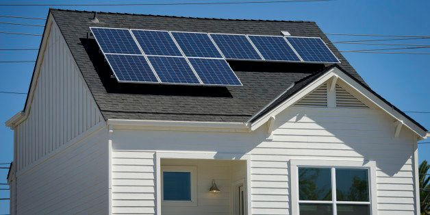 Solar panels sit on the roof of the model home at the Pacific Housing Inc. 2500 R Midtown housing development site in Sacrame