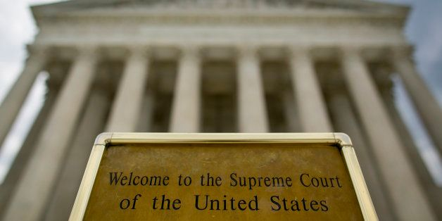 UNITED STATES - JUNE 30 - A sign welcomes visitors to the front steps of the Supreme Court in Washington on Tuesday, June 30,