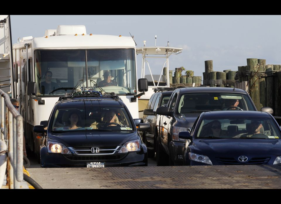 A ferry from from Ocracoke Island delivers passengers in Hatteras, N.C., Wednesday, Aug. 24, 2011. A visitor evacuation is un