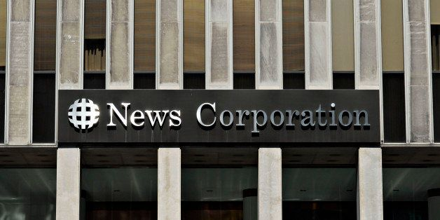 UNITED STATES - AUGUST 01:  Sunlight reflects off a News Corporation sign on the facade of News Corp. headquarters in New Yor