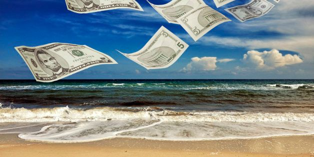 Tax Haven. Dollar bills on a sunny beach...  The Panama Papers : more than 11 million documents, which date back four decades