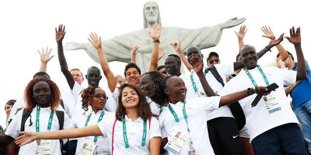 2016 Rio Olympics - Christ the Redeemer - 30/07/2016. Members of the Olympic refugee team including Yusra Mardini  from Syria