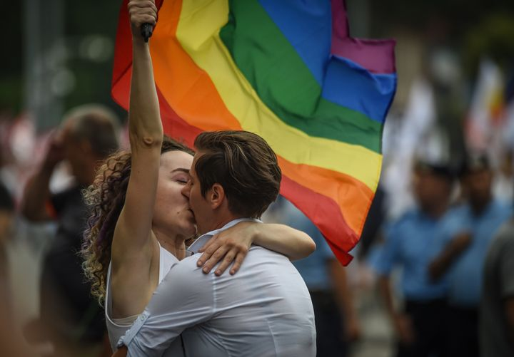 Two women kiss as they take part in the Bucharest Pride 2018 March on June 9.
