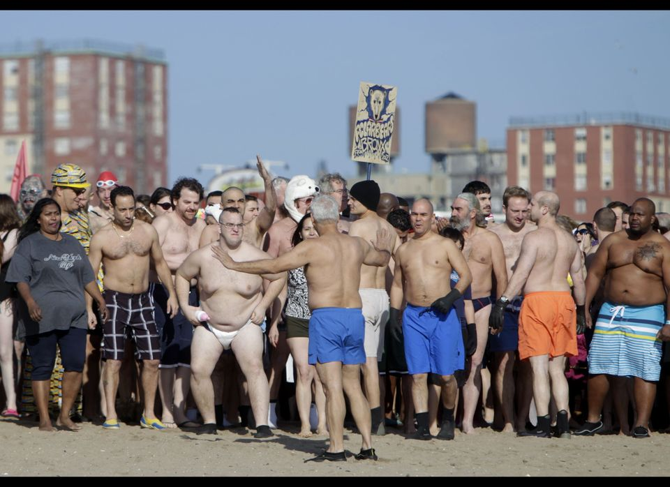 Participants in the annual New Year's Day Coney Island Polar Bear Club swim prepare to enter the ocean in New York, Sunday, J