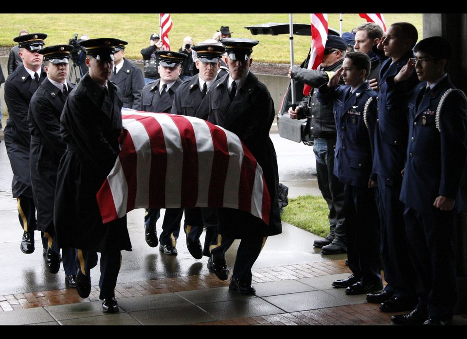 The Honor Guard carries the casket of Naval Petty Officer 2nd Class Stevenson L. Roy, a recently deceased homeless Vietnam ve
