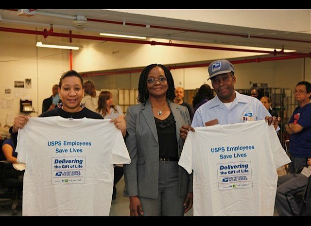 Audrey Pollard (center) stands with fellow employee marrow donors March 8.