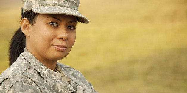 'Portrait of a female military soldier in Army Combat Uniform, Universal Camouflage Pattern or ACU.THIS IMAGE IS ONLY AVAILAB