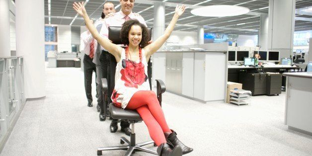 Businesspeople being silly in office
